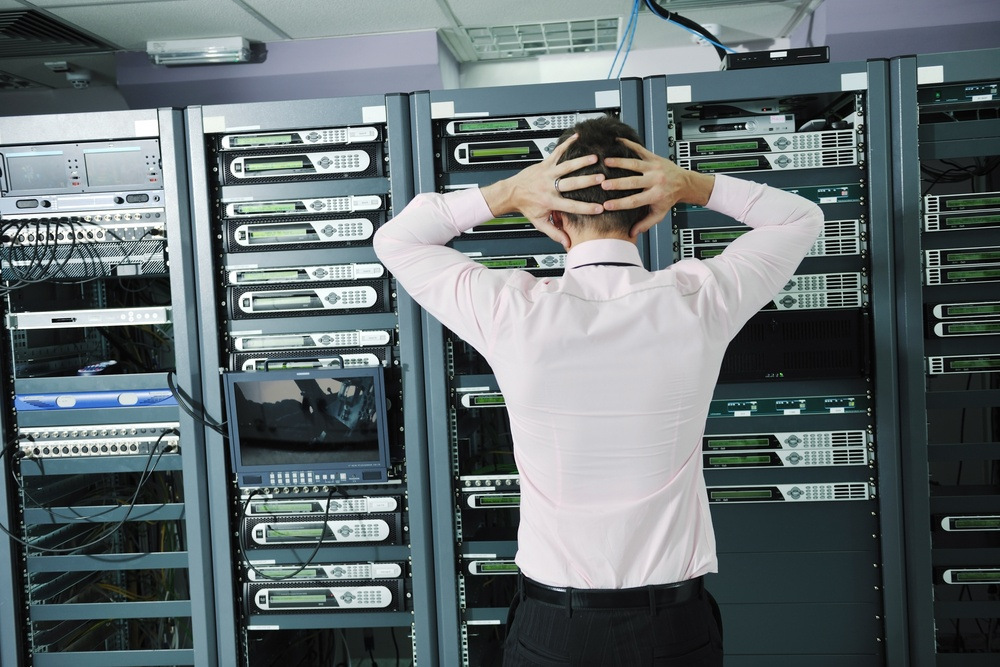 it business man in network server room have problems and looking for  disaster situation  solution-1